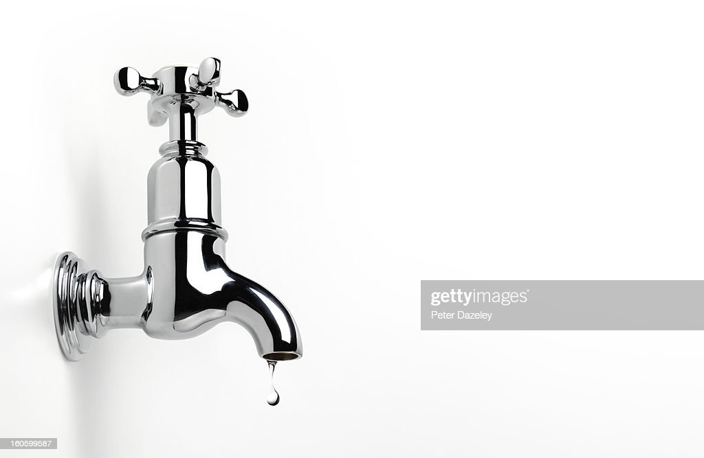 Dripping tap with copy space : Stock Photo