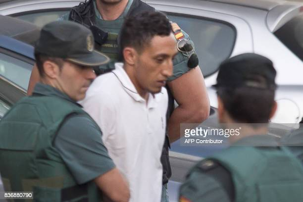 Driss Oukabir suspected of involvement in the terror cell that carried out twin attacks in Spain is escorded by Spanish Civil Guards from a detention...