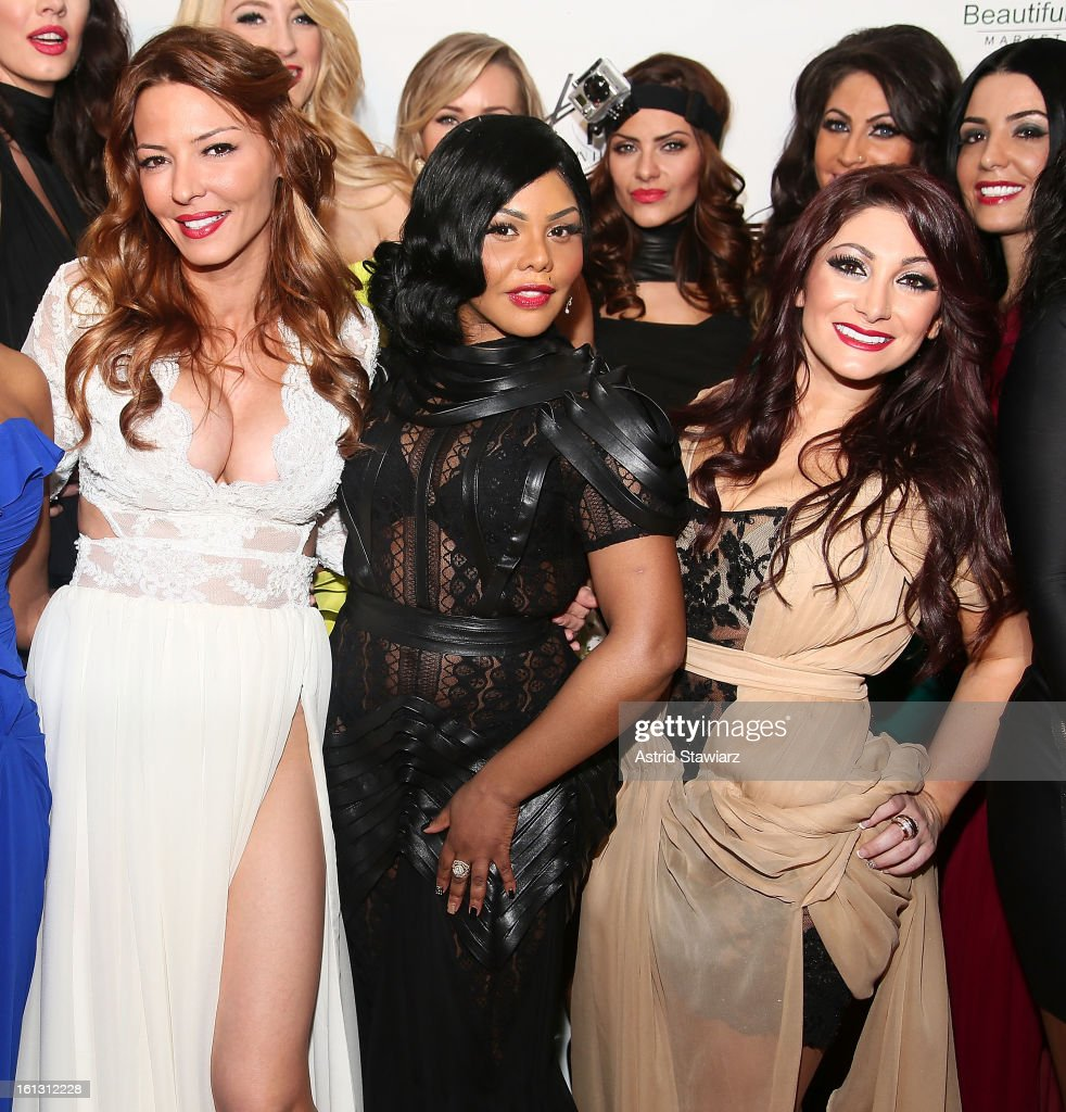 Drita D'Avanzo, Lil' Kim and Deena Cortese pose for photos backstage at the Reality of FASHION the Reality of AIDS fall 2013 fashion show during Mercedes-Benz Fashion Week at the Altman Building on February 9, 2013 in New York City.