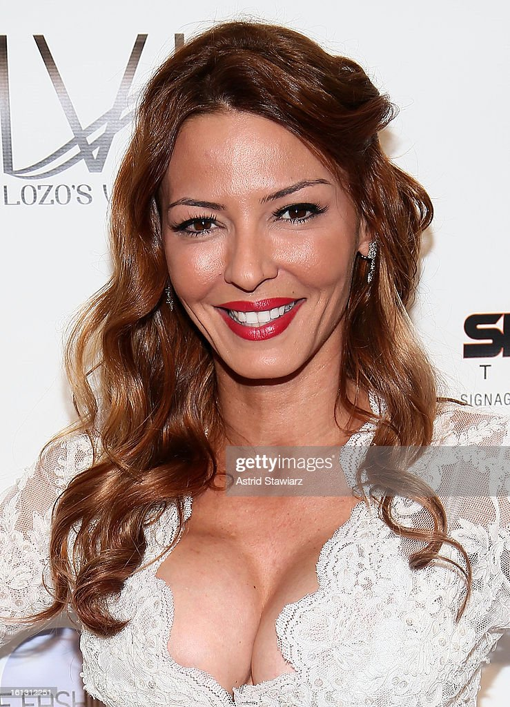 Drita D'Avanzo poses for photos backstage at the Reality of FASHION the Reality of AIDS fall 2013 fashion show during Mercedes-Benz Fashion Week at the Altman Building on February 9, 2013 in New York City.