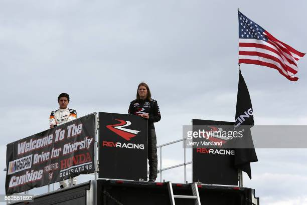 Drive for Diversity Combine participants Fabian Welter and Madeline Crane look on at New Smyrna Speedway on October 17 2017 in New Smyrna Florida