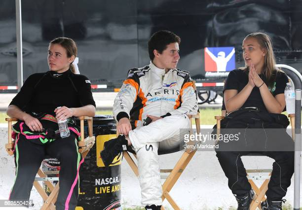 Drive for Diversity Combine participants McKenna Haase Fabian Welter and Brittany Zamora look on at New Smyrna Speedway on October 17 2017 in New...