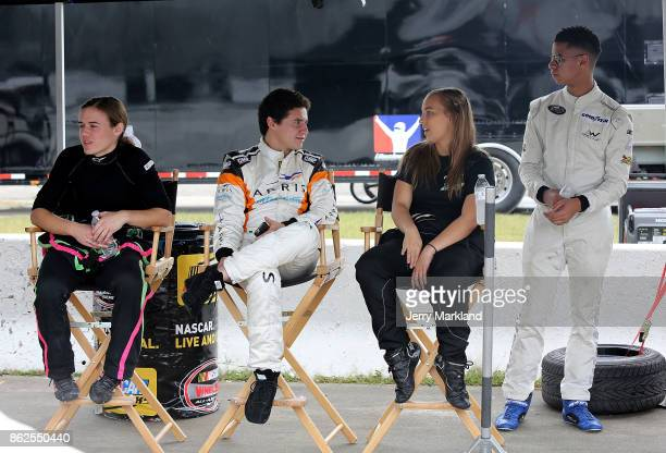 Drive for Diversity Combine participants McKenna Haase Fabian Welter Brittany Zamora and Armani Williams look on at New Smyrna Speedway on October 17...