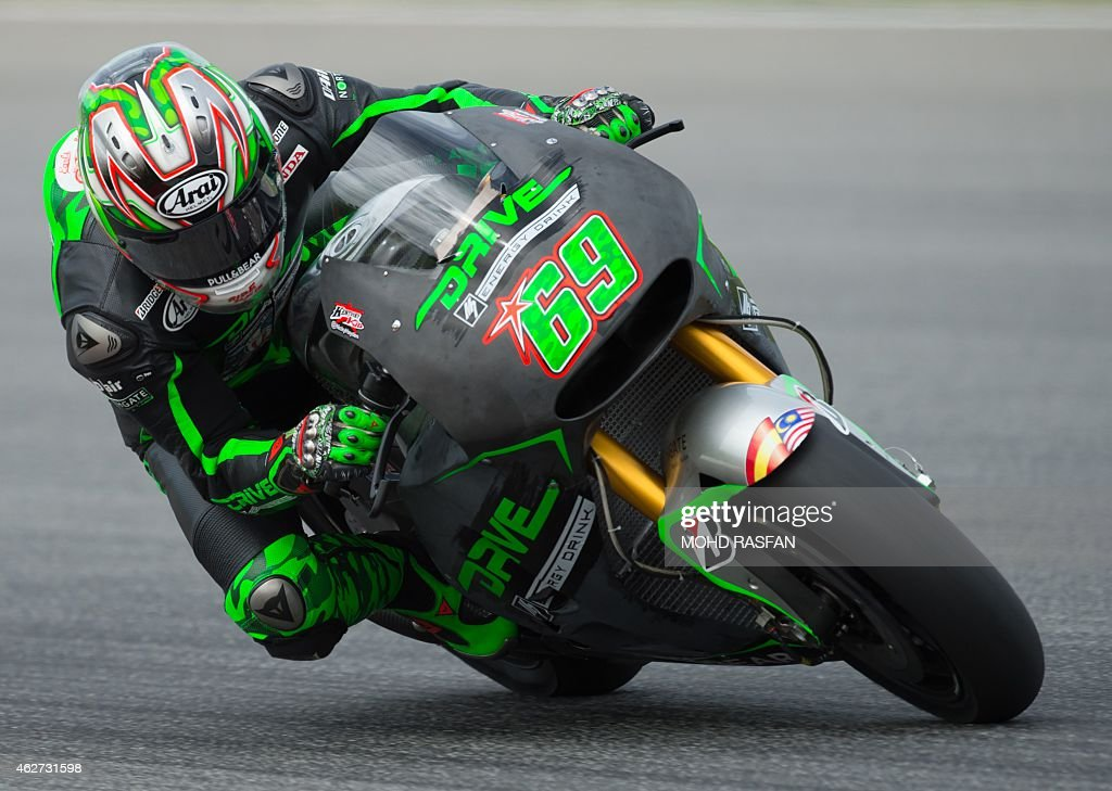 Drive M7 Aspar rider <a gi-track='captionPersonalityLinkClicked' href=/galleries/search?phrase=Nicky+Hayden+-+Piloto+de+motociclismo&family=editorial&specificpeople=227346 ng-click='$event.stopPropagation()'>Nicky Hayden</a> of the US steers his bike during the first MotoGP pre-season testing session on the first day at the Sepang circuit outside Kuala Lumpur on February 4, 2015.