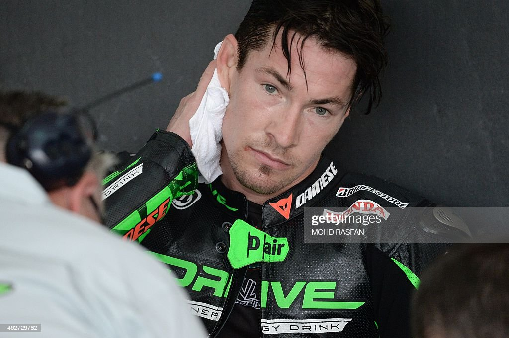 Drive M7 Aspar rider <a gi-track='captionPersonalityLinkClicked' href=/galleries/search?phrase=Nicky+Hayden+-+Piloto+de+motociclismo&family=editorial&specificpeople=227346 ng-click='$event.stopPropagation()'>Nicky Hayden</a> of the US wipes away sweat inside his team garage during the first day of MotoGP pre-season testing at the Sepang circuit outside Kuala Lumpur on February 4, 2015.