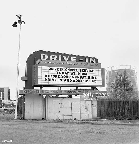 A drivein movie theater marquee announces Sunday drivein chapel services