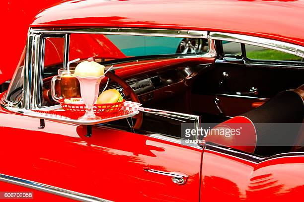 Drive-In window tray on a red 1957 Chevrolet