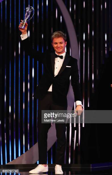 Driver and Laureus Ambassador Nico Rosberg of Germany with his Laureus World Breakthrough of the Year Award trophy on stage during the 2017 Laureus...