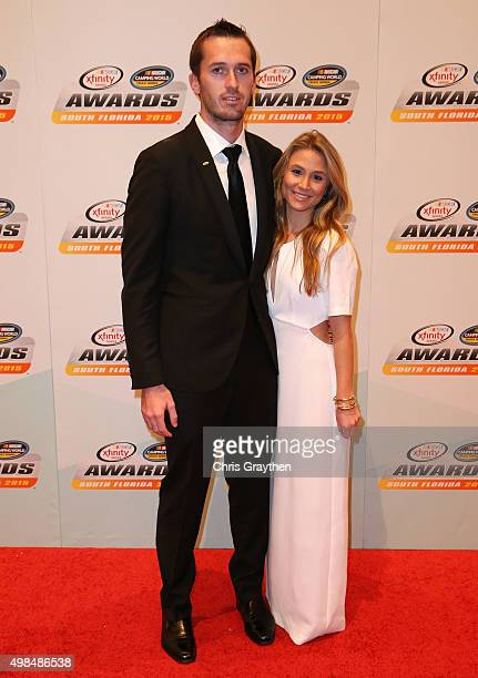 NASCAR driver Ben Kennedy and girlfriend Chelsea Saunders pose on the red carpet during the NASCAR Camping World Truck Series and XFINITY Series...