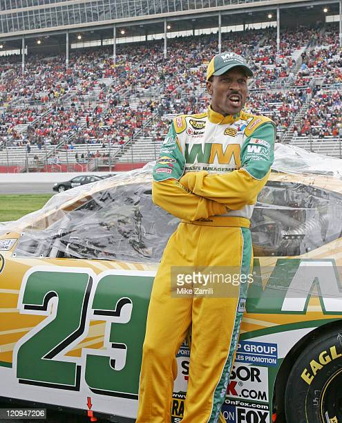 NASCAR driver Bill Lester poses with his car before the Golden Corral 500 NASCAR race at Atlanta Motor Speedway in Hampton Georgia March 19 2006