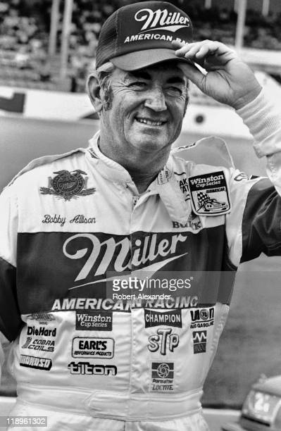 NASCAR driver Bobby Allison poses for photographers at the Daytona International Speedway prior to the start of the 1987 Daytona 500 on February 15...