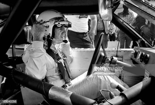 NASCAR driver Bobby Allison prepares for the start of the 1983 Firecracker 400 at the Daytona International Speedway on July 4 1983 in Daytona Beach...