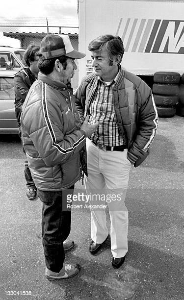 NASCAR driver Bobby Allison right talks with his brother fellow race driver Donnie Allison in the Daytona International Speedway garage prior to the...