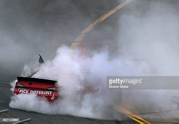 NASCAR driver Brad Keselowski disappears in a cloud of burning rubber smoke as he celebrates his win in a clean sweep weekend taking the Camping...