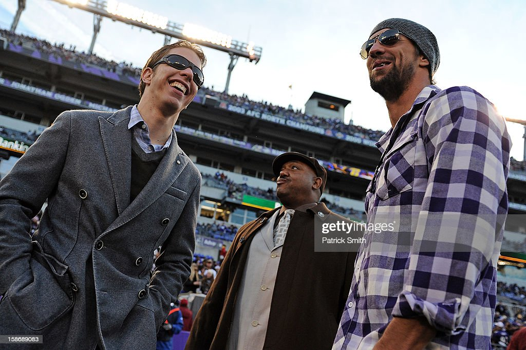NASCAR driver Brad Keselowski (L), the 2012 Sprint Cup champion, laughs with olympian Michael Phelps (R) before the the New York Giants play the Baltimore Ravens at M&T Bank Stadium on December 23, 2012 in Baltimore, Maryland.