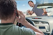 Driver calling using smartphone in car is going to hit pedestrian.
