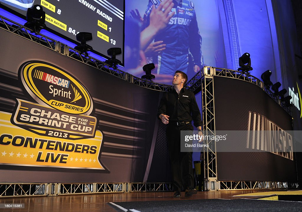 NASCAR driver <a gi-track='captionPersonalityLinkClicked' href=/galleries/search?phrase=Carl+Edwards+-+Racecar+Driver&family=editorial&specificpeople=193803 ng-click='$event.stopPropagation()'>Carl Edwards</a> is introduced during the Chase for the Sprint Cup Contenders Live on September 12, 2013 in Chicago, Illinois.