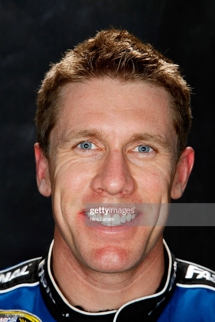 Driver <a gi-track='captionPersonalityLinkClicked' href=/galleries/search?phrase=Carl+Edwards&family=editorial&specificpeople=193803 ng-click='$event.stopPropagation()'>Carl Edwards</a> poses during portraits for the 2013 NASCAR Sprint Cup Series at Daytona International Speedway on February 14, 2013 in Daytona Beach, Florida.