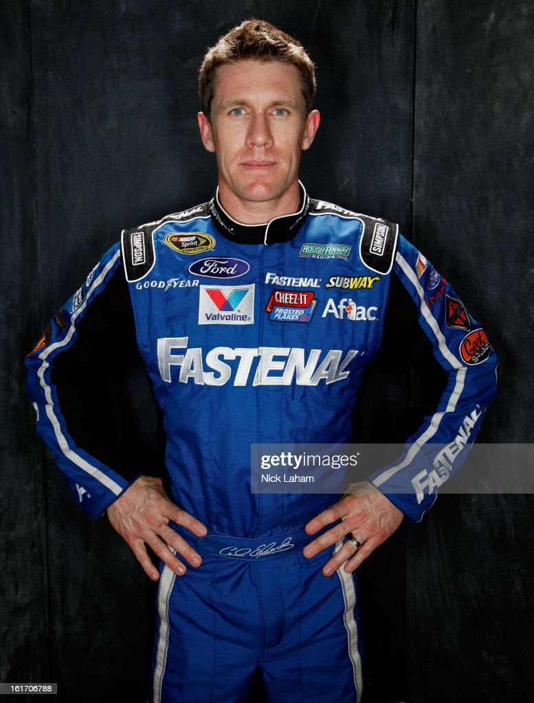Driver Carl Edwards poses during portraits for the 2013 NASCAR Sprint Cup Series at Daytona International Speedway on February 14, 2013 in Daytona Beach, Florida.