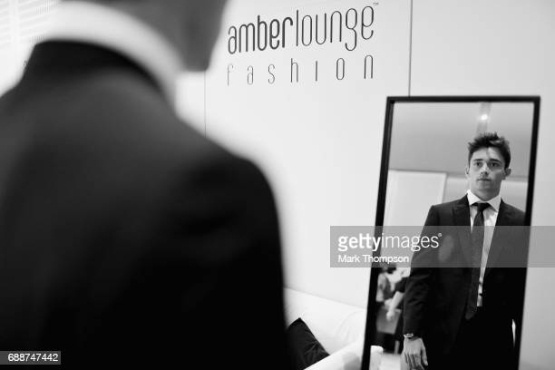 F2 driver Charles Leclerc prepares for the Amber Lounge fashion show backstage during previews to the Monaco Formula One Grand Prix at Circuit de...