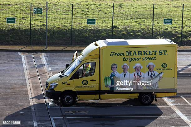 A driver climbs into a Wm Morrison Supermarkets Plc branded customer delivery vehicle at the Ocado Group Plc distribution centre in Dordon UK on...