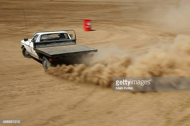 A driver competes in the ute barrel races on the first day of the 2014 Deni Ute Muster at the Play on the Plains Festival grounds on October 3 2014...