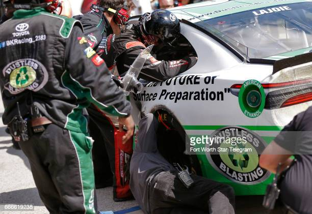 NASCAR driver Corey LaJoie's pit crew work to make repairs to the car during the O'Reilly Auto Parts 500 on Sunday April 9 2017 at Texas Motor...