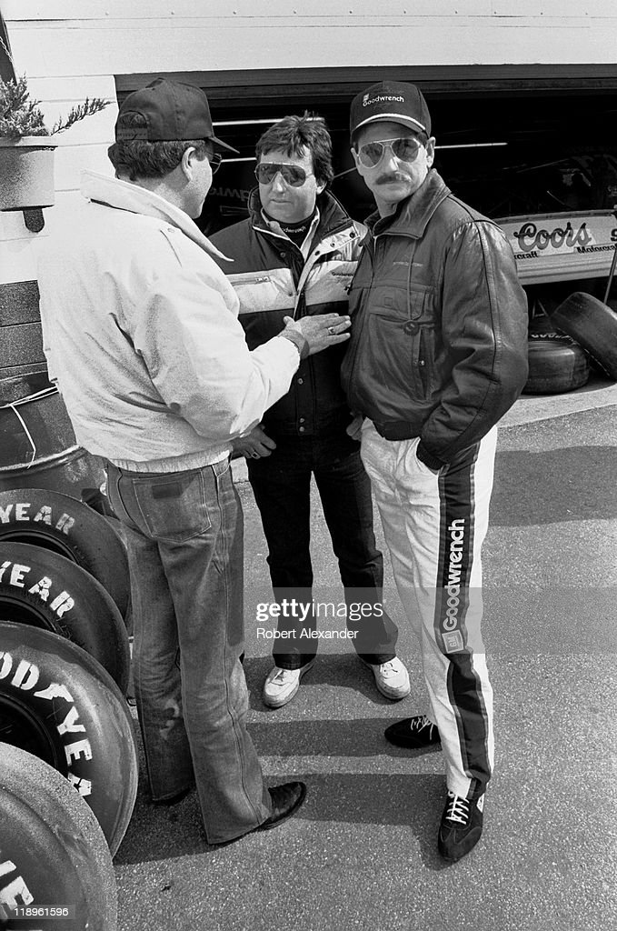 NASCAR driver Dale Earnhardt and his car owner Richard Childress talk with a friend in the Daytona International Speedway garage area prior to the...