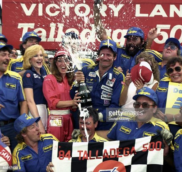 Driver Dale Earnhardt celebrates in victory lane after winning the Talladega 500 on July 29 1984 at the Alabama International Speedway in Talladega...