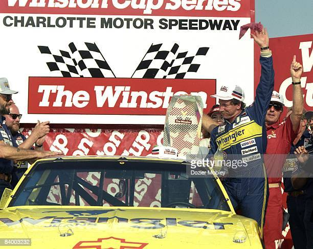 Driver Dale Earnhardt celebrates in Victory Lane after winning The Winston All Star race on May 17 1987 at the Charlotte Motor Speedway in Concord...