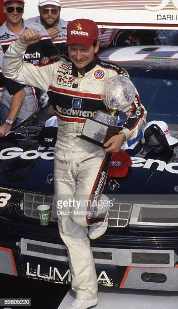 Driver Dale Earnhardt celebrates in Victory Lane after winning the Heinz Southern 500 race on September 3 1989 at the Darlington Raceway in...