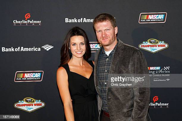 Driver Dale Earnhardt Jr and Amy Reimann pose during the NASCAR Evening Series at Charlie Palmer Steak part of the Four Seasons Hotel Las Vegas on...