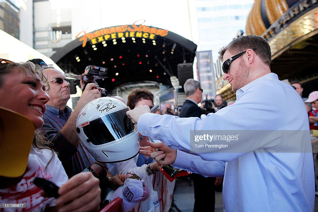 Driver <a gi-track='captionPersonalityLinkClicked' href=/galleries/search?phrase=Dale+Earnhardt+Jr.&family=editorial&specificpeople=171293 ng-click='$event.stopPropagation()'>Dale Earnhardt Jr.</a> greets and signs autographs for fans during NASCAR Fanfest presented by Las Vegas Motor Speedway at the Fremont Street Experience on November 28, 2012 in Las Vegas, Nevada.