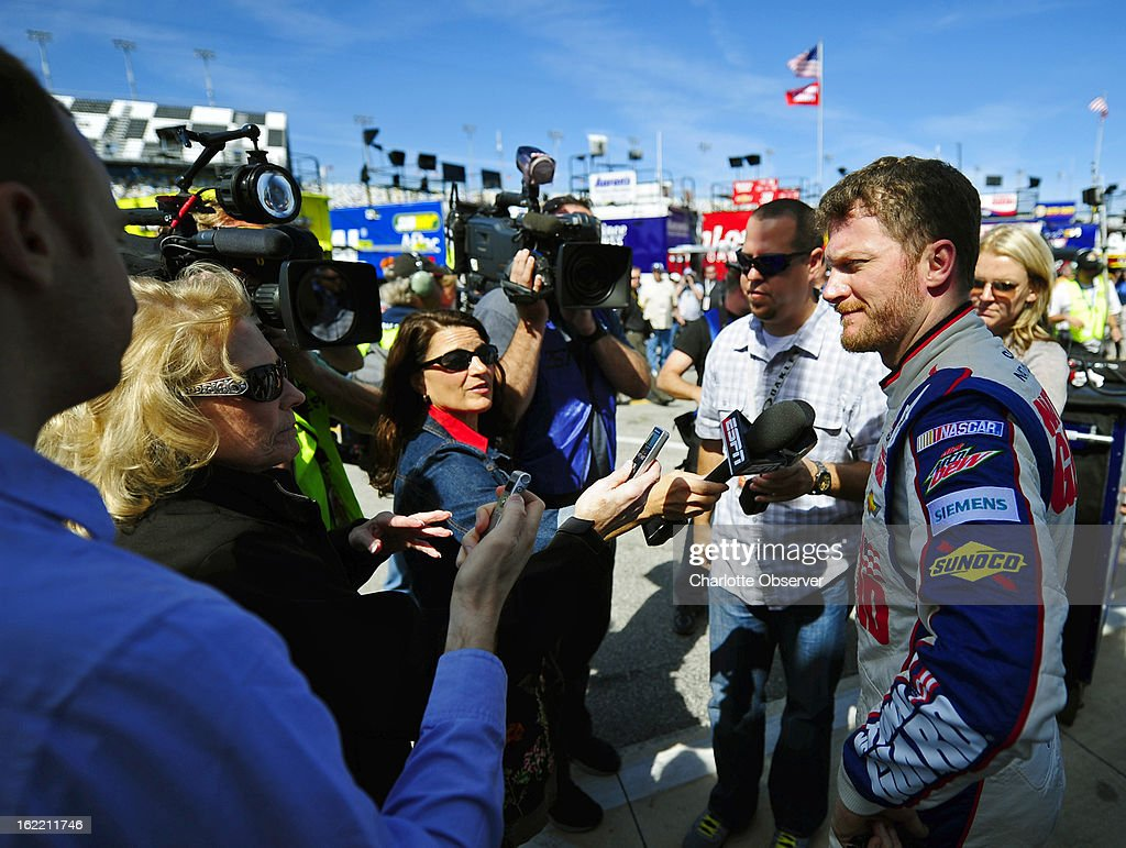 NASCAR driver Dale Earnhardt Jr. is interviewed after running practice laps on Wednesday, Febraury 20, 2013, at Daytona International Speedway in Daytona, Florida.
