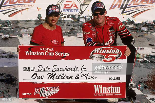 Driver Dale Earnhardt Jr poses with his winning check after the EA Sports 500 at the Talladega Superspeedway in Talladaga Alabama