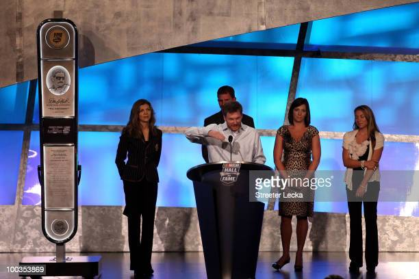 Driver Dale Earnhardt Jr speaks as Teresa Earnhardt Kerry Earnhardt Kelley Earnhardt Elledge and Taylor Earnhardt stand on stage as Dale Earnhardt Sr...