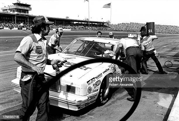 NASCAR driver Dale Earnhardt Sr driving the No 15 car owned by Bud Moore makes a pit stop during the 1982 Firecracker 400 at the Daytona...