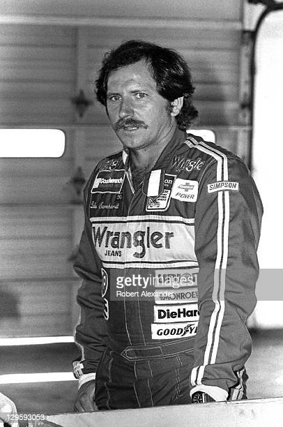 NASCAR driver Dale Earnhardt Sr pauses in the Daytona International Speedway garage prior to the start of the 1983 Daytona 500 on February 20 1983 in...