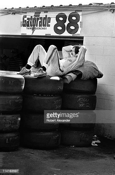 NASCAR driver Dale Earnhardt Sr relaxes in the Daytona International Speedway garage while waiting for a practice session to get underway at the 1982...