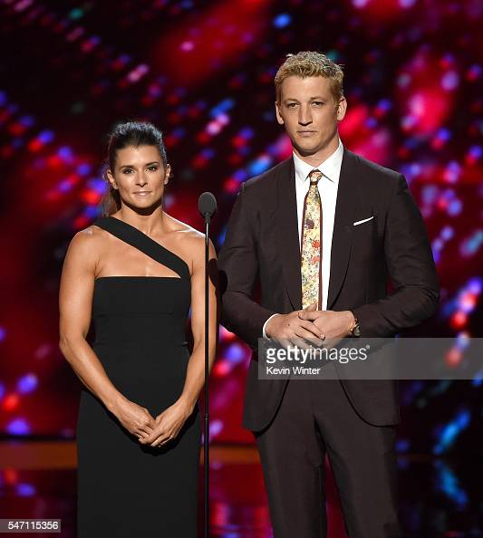 NASCAR driver Danica Patrick and actor Miles Teller speak onstage during the 2016 ESPYS at Microsoft Theater on July 13 2016 in Los Angeles California