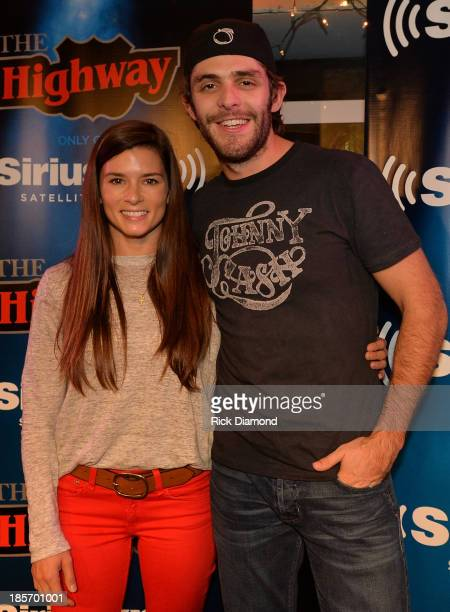 NASCAR Driver Danica Patrick and Singer/Songwriter Thomas Rhett pose after a taping of SiriusXM The Highway VIP Performance featuring Thomas Rhett...
