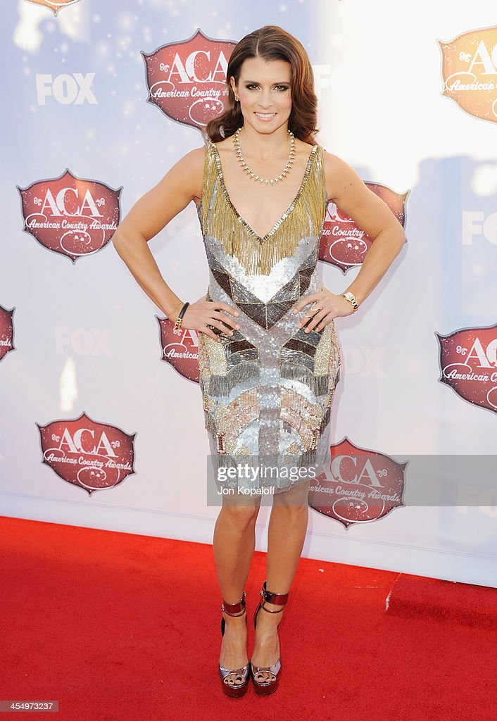 NASCAR driver <a gi-track='captionPersonalityLinkClicked' href=/galleries/search?phrase=Danica+Patrick&family=editorial&specificpeople=183352 ng-click='$event.stopPropagation()'>Danica Patrick</a> arrives at the American Country Awards 2013 at the Mandalay Bay Events Center on December 10, 2013 in Las Vegas, Nevada.