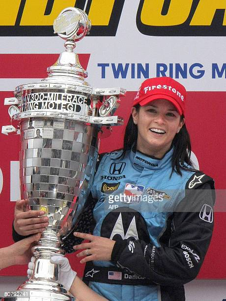 US driver Danica Patrick holds the winner's trophy after finishing first in the Indy Japan 300 at the Twin Ring Motegi race course on April 20 2008...
