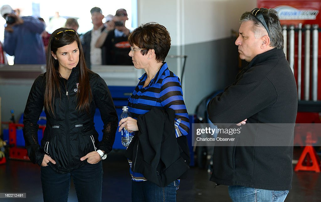 NASCAR driver Danica Patrick, left, waits in her garage stall with her parents, Bev and T.J. Patrick, prior to running practice laps on Wednesday, Febraury 20, 2013, at Daytona International Speedway in Daytona Beach, Florida.