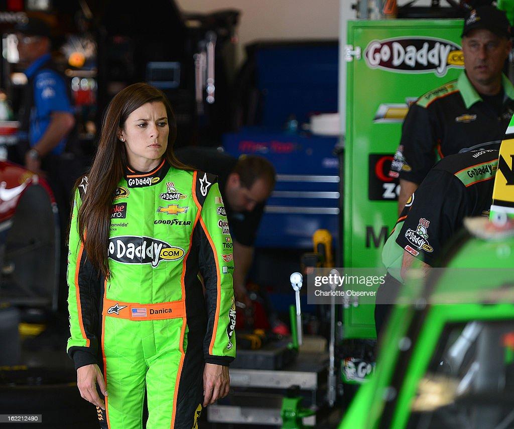NASCAR driver Danica Patrick looks at her car as crew members make adjustments following practice laps on Wednesday, Febraury 20, 2013, at Daytona International Speedway in Daytona Beach, Florida.