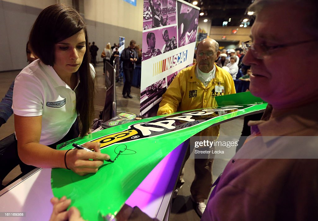 NASCAR driver, <a gi-track='captionPersonalityLinkClicked' href=/galleries/search?phrase=Danica+Patrick&family=editorial&specificpeople=183352 ng-click='$event.stopPropagation()'>Danica Patrick</a>, signs autographs for fans during the NASCAR Preview at the NASCAR Hall of Fame on February 9, 2013 in Charlotte, North Carolina.
