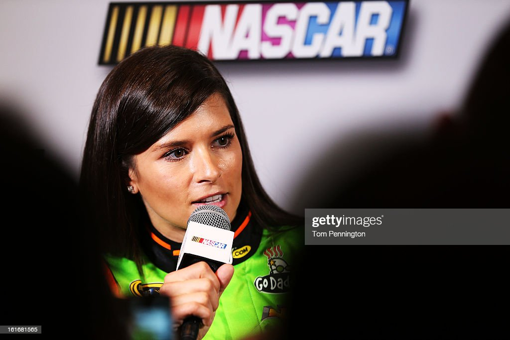 Driver <a gi-track='captionPersonalityLinkClicked' href=/galleries/search?phrase=Danica+Patrick&family=editorial&specificpeople=183352 ng-click='$event.stopPropagation()'>Danica Patrick</a> speaks to the media during the 2013 NASCAR media day at Daytona International Speedway on February 14, 2013 in Daytona Beach, Florida.