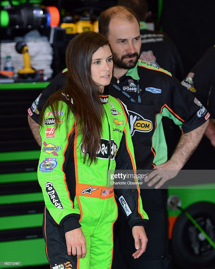 NASCAR driver Danica Patrick watches as crew members make adjustments to her car following practice laps on Wednesday, Febraury 20, 2013, at Daytona International Speedway in Daytona Beach, Florida.