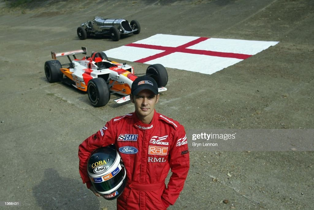 Driver Darren Manning of Great Britain poses on the Brooklands banking with John Cobb's Napier Railton and his Champ car during the official launch of Team St George in the CART Fedex Championship at Brooklands Museum, Weybridge on September 5, 2002.