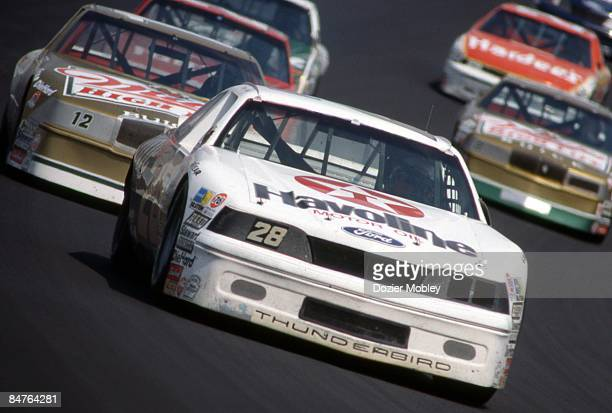 Driver Davey Allison leads the way to victory at the Miller High Life 400 race on September 11 1988 at the Ricmond International Raceway in Richmond...